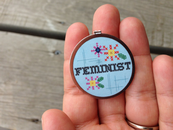 feminist cross stitch pin brooch Holey Socks Art